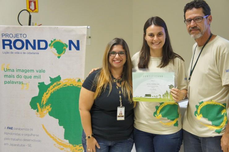 Mariana Prado Mueller (Núcleo de Extensão), Ana Paula Freiberger Caron (Psicologia), Marco Antonio R. Pedroso (coordenador do curso de Design e coordenador do Projeto Rondon na FAE).
