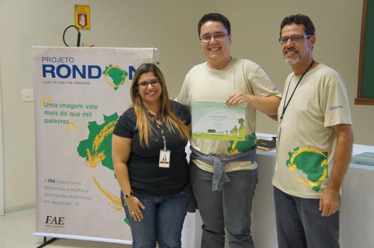 Mariana Prado Mueller (Núcleo de Extensão), Faiçal Raymond Hayward Isidoro (Direito), Marco Antonio R. Pedroso (coordenador do curso de Design e coordenador do Projeto Rondon na FAE).
