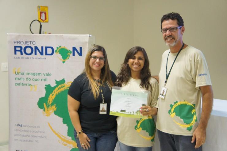 Mariana Prado Mueller (Núcleo de Extensão), Larissa Lopes Endlich (Engenharia Ambiental), Marco Antonio R. Pedroso (coordenador do curso de Design e coordenador do Projeto Rondon na FAE).